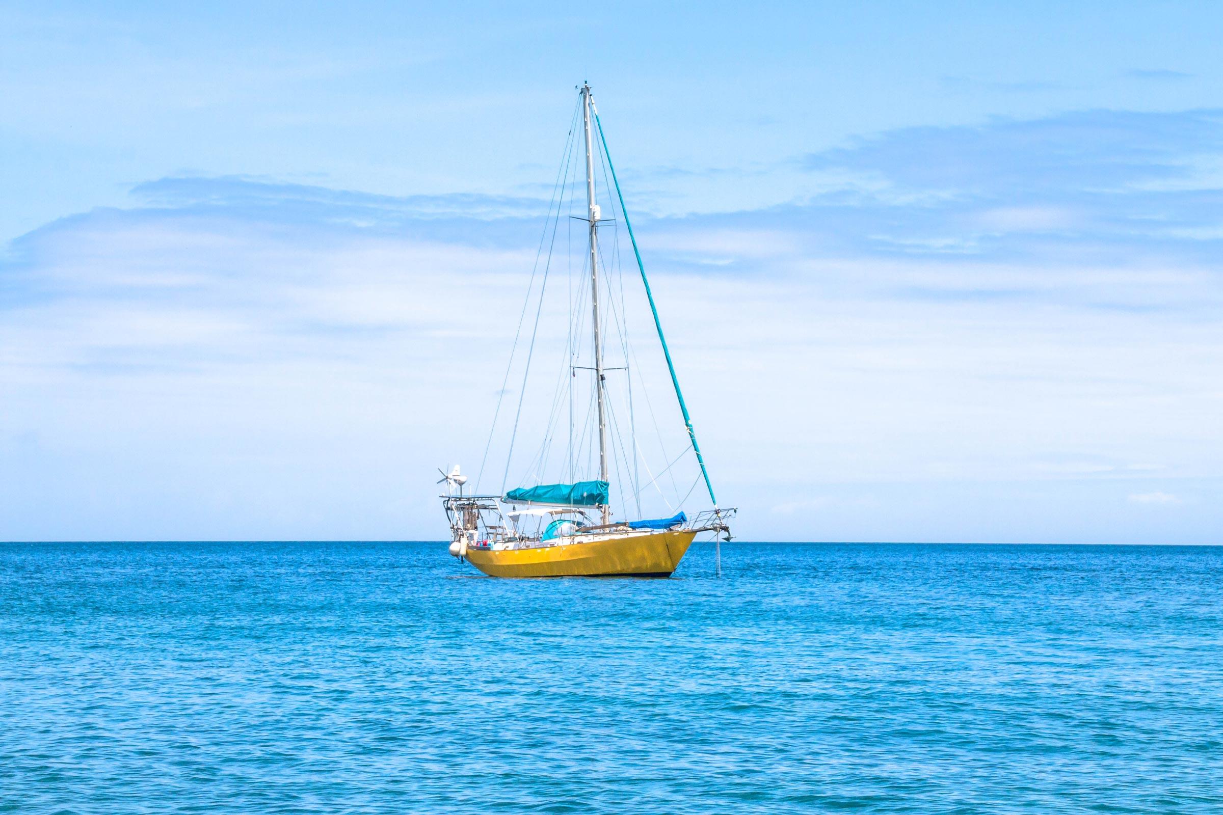 Blue sea with yello boat