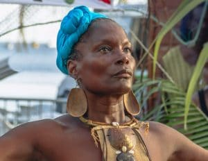 afro woman with blue scarf